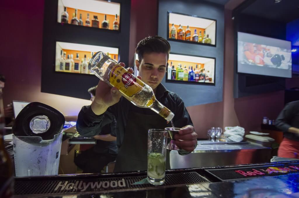 Cuban bartender making a Mojito in a bar in Havana
