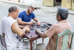 Three Cuban Men playing Dominoes on the Streets of Havana, Cuba