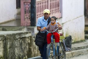 Locals Cycling in Baracoa