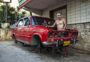 Man fixing a car in Cuba