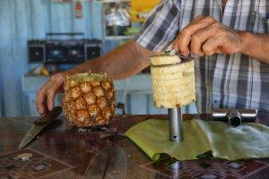 Man making pineapple juice, Viñales, Cuba