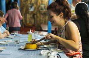 Young woman enjoying a flan, Viñales, Cuba